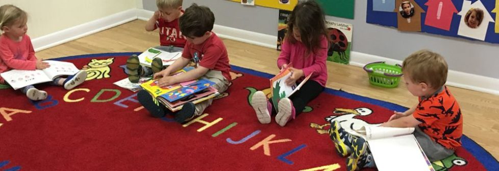 ecc-kids-reading-on-carpet