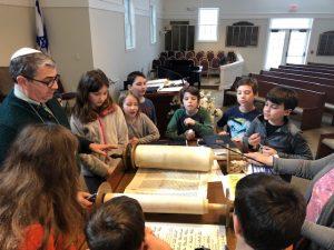 Teacher students torah scrolls at Shir Shalom